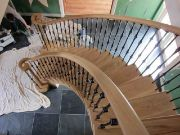 Sweeping Oak Stairs with Metal Bulatrades